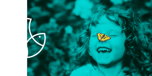 Child with a yellow butterfly in the nose and cutter products white logo