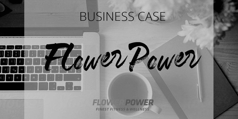 office table with laptop, mug and notebook with the title business case flower power black and white