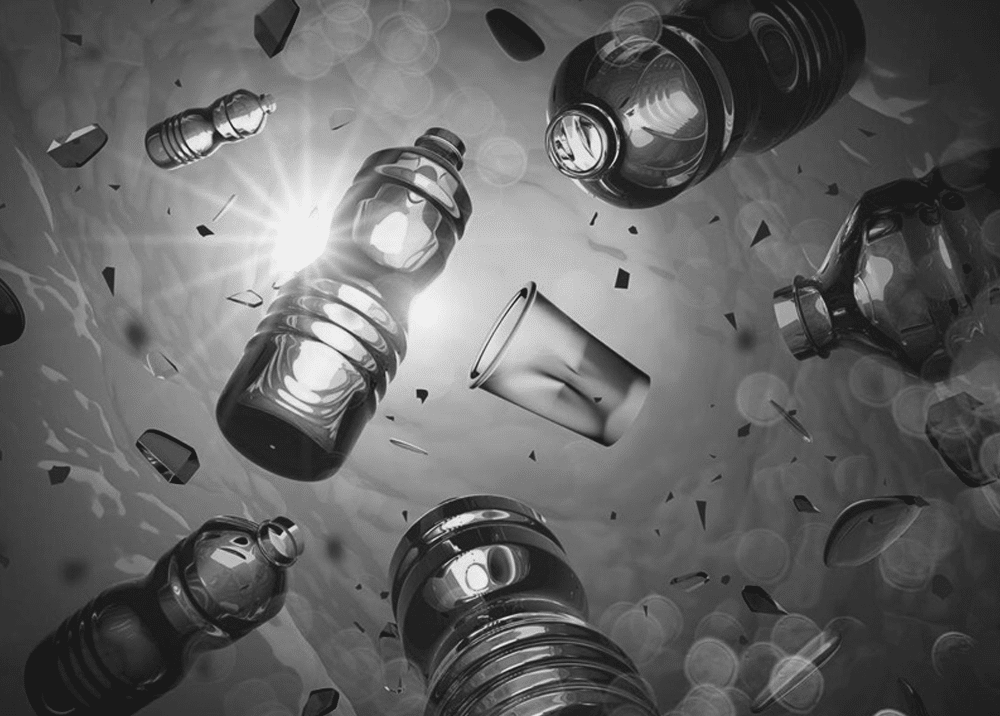 plastic bottles and cups floating in the sea black and white
